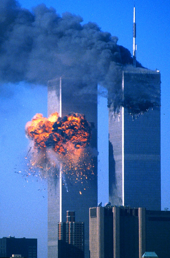 The World Trade Center south tower (left) burst into flames after being struck by hijacked United Airlines Flight 175 as the north tower burns following an earlier attack by a hijacked airliner in New York City on September 11, 2001