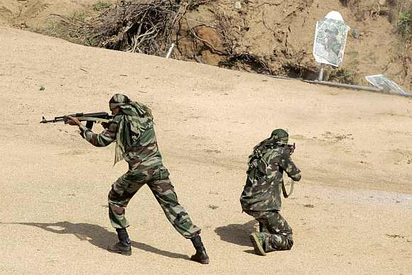 Security personnel train at a counter-terrorism and jungle warfare school in Kanker village, about 140 km south of Raipur