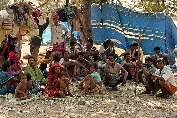 A group of tribe sit in open at a camp run by the Salwa Judum in Dornapal in Chhattisgarh