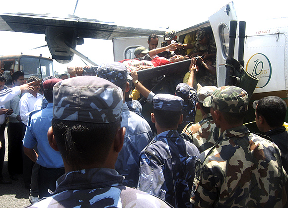 Airhostess Roshni Saiju is brought to the hospital for treatment after being rescued from a plane crash site, at Pokhara airport