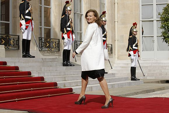Valerie Trierweiler, companion of France's newly-elected President Francois Hollande, arrives on the red carpet in the courtyard of the Elysee Palace for the handover ceremony between Hollande and outgoing President Nicolas Sarkozy in Paris