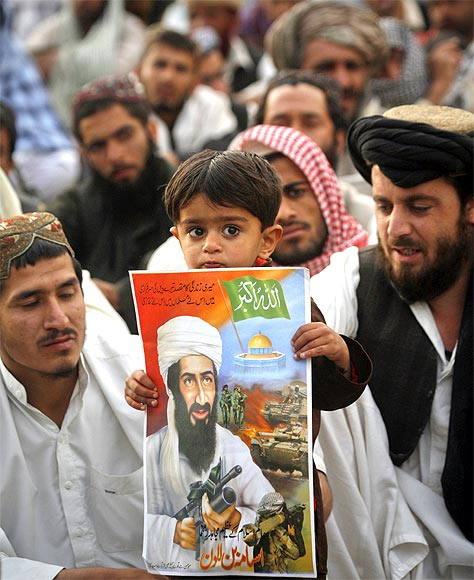 A child holds an image of Al Qaeda leader Osama bin Laden during an anti-American rally