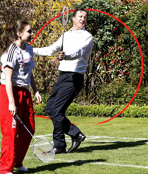 Britain's Prime Minister David Cameron plays a game of badminton in the garden of 10 Downing Street with school athletes and London 2012 Organising Committee chairman Sebastian Coe