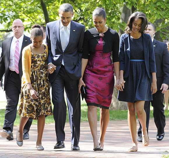 Obama walks from the White House to a church service with his wife Michelle and their daughters Sasha and Malia in Washington