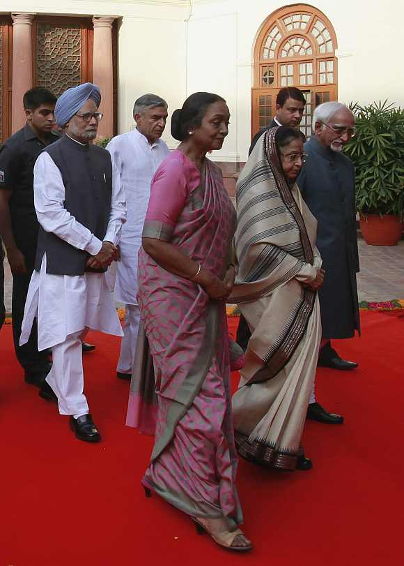 Prime Minister Manmohan Singh, Parliamentary Affairs Minister Pawan Kumar Bansal, Lok Sabha Speaker Meira Kumar, President Pratibha Patil and Vice President Mohammad Hamid Ansari walk during a procession upon their arrival to attend a function on the occasion of the 60th anniversary of Indian Parliament's first session in New Delhi May 13