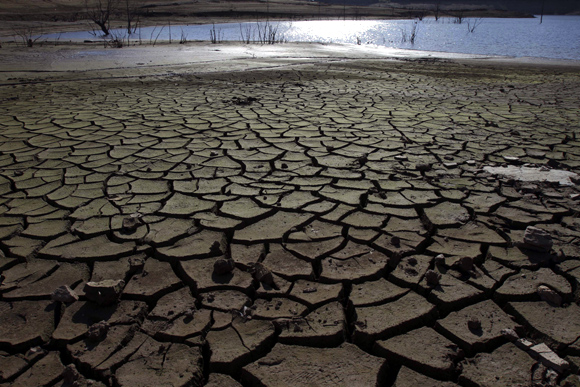 Cracked earth of the drought-stricken Portodemouros reservoir, northern Spain