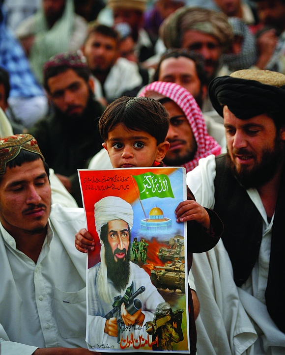 A child holds an image of al-Qaeda leader Osama bin Laden during an anti-American rally organised by the Pakistani religious party Jamiat-e-Ulema-e-Islam in Quetta