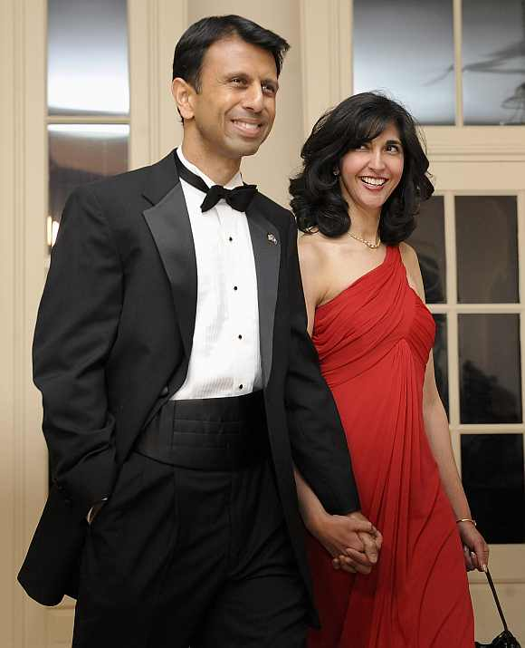 Jindal arrives with his wife for a dinner held for the National Governors Association by Obama at the White House