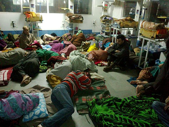 An overcrowded ward at the hospital where attendants of patients are seen jostling for space