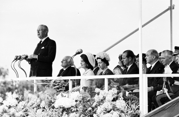 Former British prime minister Harold Macmillan (1894 - 1986) gives a speech at the inauguration ceremony of a memorial to John F Kennedy at Runnymede. Behind him on the stand are Jackie Kennedy, Queen Elizabeth II, Prince Philip, and prime minister Harold Wilson (1916 - 1995, far right). Photo taken on May 14, 1965