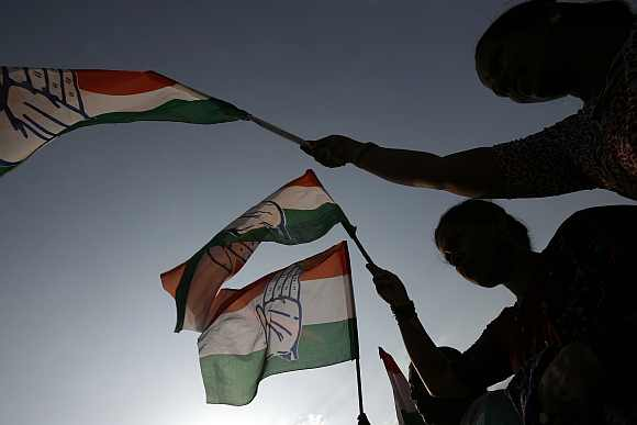 Congress supporters wave the party flag in Bengaluru