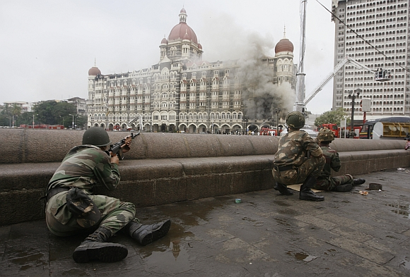 Soldiers take position during a gun battle at the Taj Mahal hotel in Mumbai