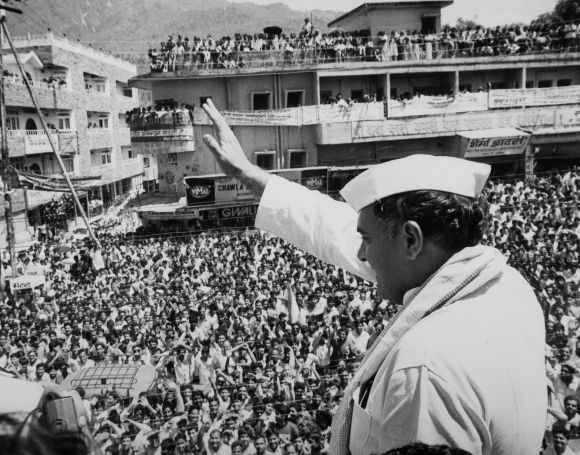 Archival image shows Rajiv Gandhi waving to the crowd during a campaign rally in Rishikesh
