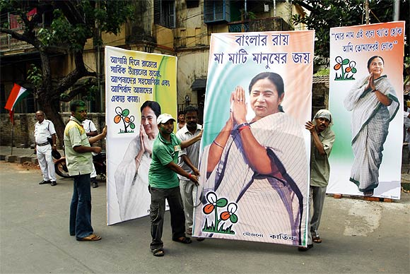 Trinamool supporters with posters of Mamata Banerjee