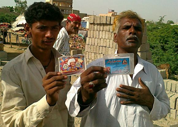 Pakistani Hindus flashing their ID cards