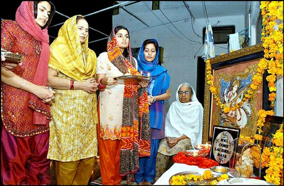 Pakistani Hindu women offer prayers at a temple