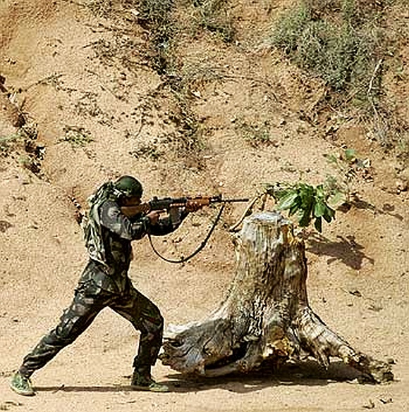 A paramilitary trooper trains at the Jungle Warfare School in Kanker village, Chhattisgarh