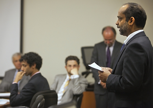 Ravi Pazhani, father of Dharun Ravi reads a statement during a hearing in New Brunswick, New Jersey