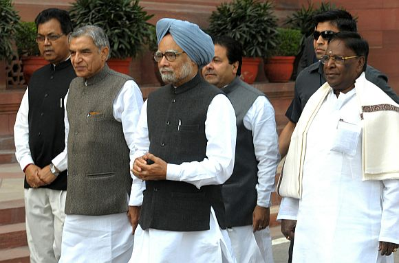 Prime Minister Manmohan Singh arrives at the Parliament House to attend the Budget Session, in New Delhi