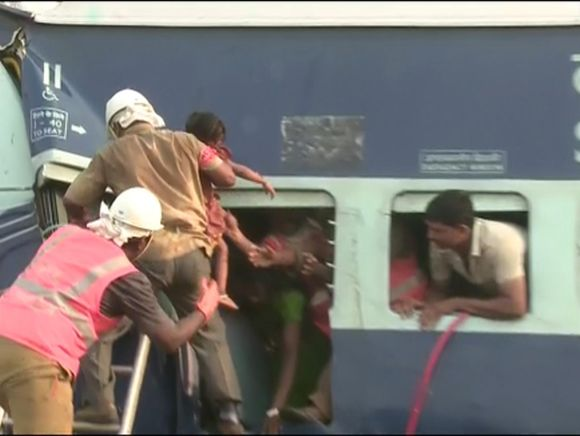Passengers trapped in the derailed train being rescued