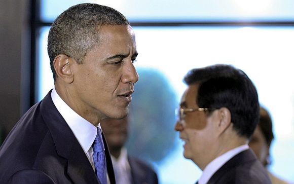 US President Barack Obama walks past his Chinese counterpart Hu Jintao as he arrives for the 2011 G20 Summit in Cannes
