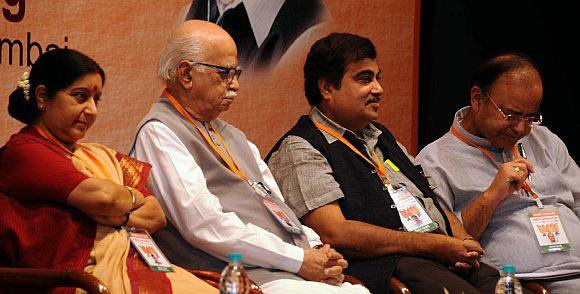 BJP President Nitin Gadkari with L K Advani, Sushma Swaraj and Arun Jaitley at the Mumbai meet