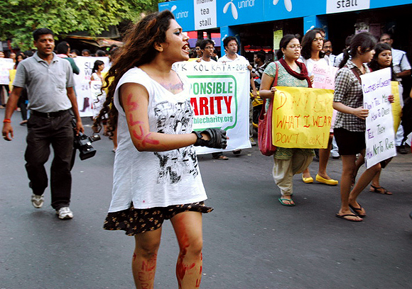 A woman shouts slogans against sexual harrasment during the parade in Kolkata