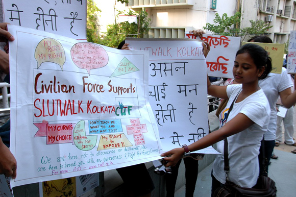 Teenagers carry posters with slogans against sexual violence in Kolkata