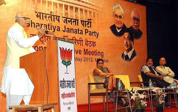 Senior BJP leader L K Advani delivers a speech at Mumbai's Y B Chavan Auditorium as Sushma Swaraj, Nitin Gadkari and Arun Jaitley listen intently