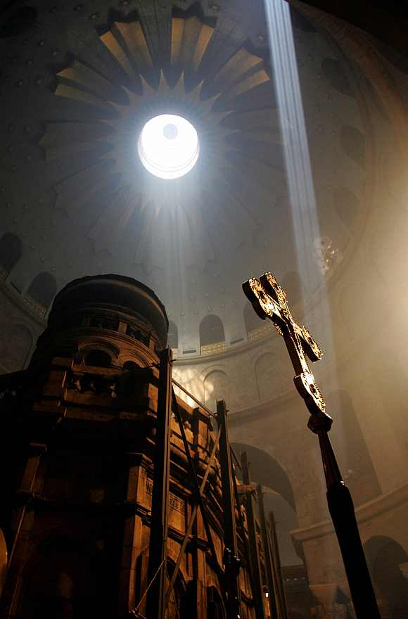 A ray of light descends from the dome of the Church of the Holy Sepulcher before the Holy Fire ceremony in Jerusalem. The Holy Fire ceremony is part of Orthodox Easter and the flame symbolizes the resurrection of Christ