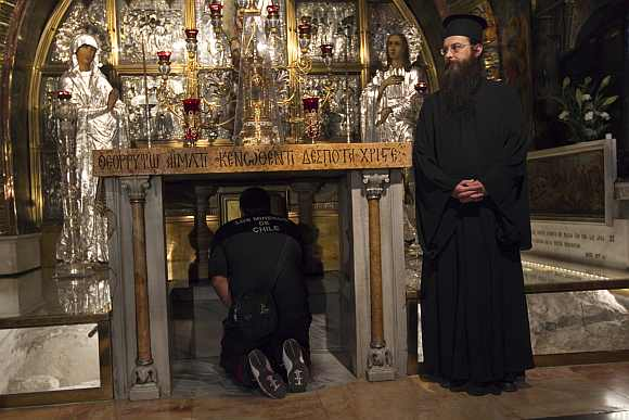 A man prays at the Church of the Holy Sepulchre, the traditional site of Jesus' crucifixion
