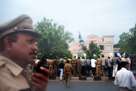 Police and media line up outside the CBI office in Hyderabad