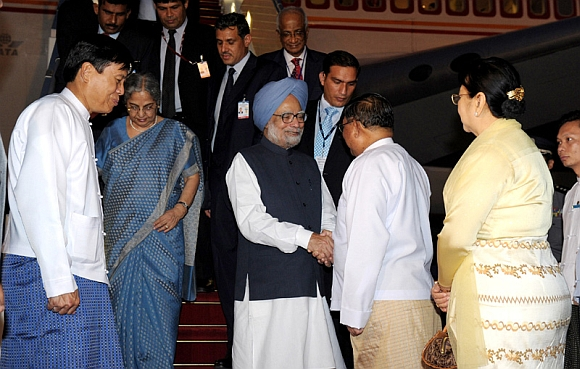 Dr Manmohan Singh and his wife Gursharan Kaur being received by the Minister of Foreign Affairs of Myanmar U Wunna Maung Lwin on their arrival at Nay Pyi Taw International Airport, Myanmar