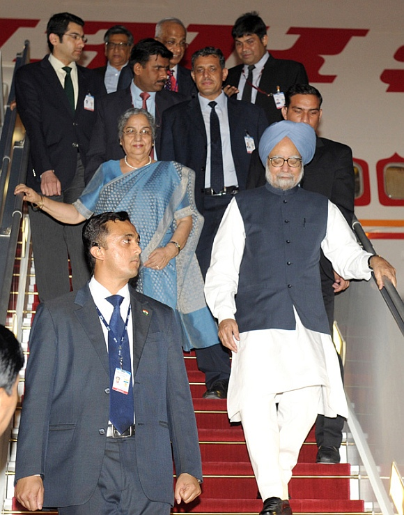 Prime Minister Dr Manmohan Singh and his wife Gursharan Kaur arrive at Nay Pyi Taw International Airport, Myanmar
