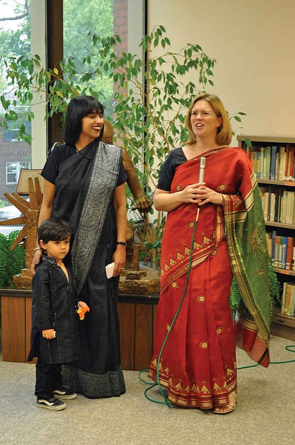 Gandhi Memorial Center Director Carrie Trybulec (right), introduces Leena Jayaswal, as Jayaswal's son Dev looks on