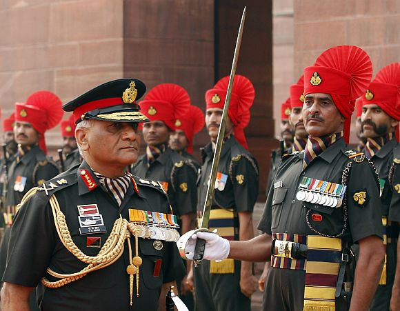 Army Chief General V K Singh inspects the guard of honour after taking over the charge, in New Delhi