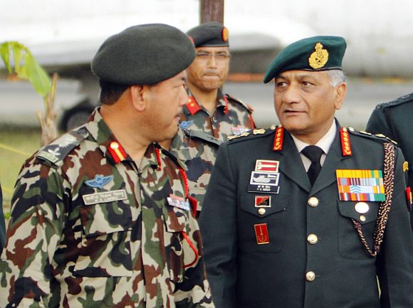 General V K Singh walks during a regional seminar organised by the Nepal army, in Kathmandu