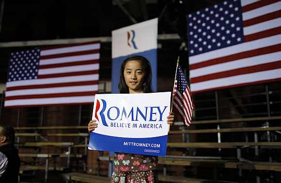 Evelyn Duffy, 9-years-old, a supporter of Romney poses at the site of his primary night rally in Manchester