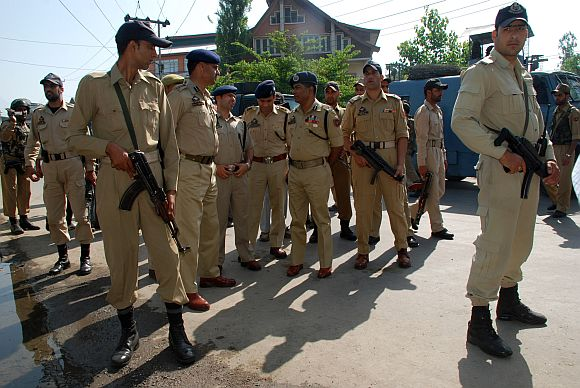 Senior security officials inspect the site of the militant attack, in Srinagar on Wednesday