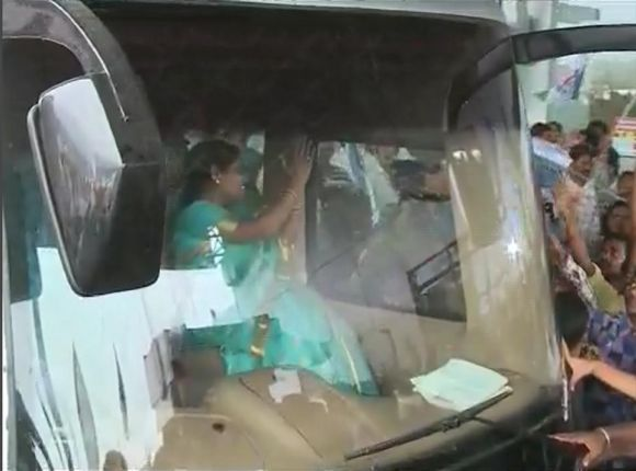 Video grab shows Vijayamma waving to crowds during the road show