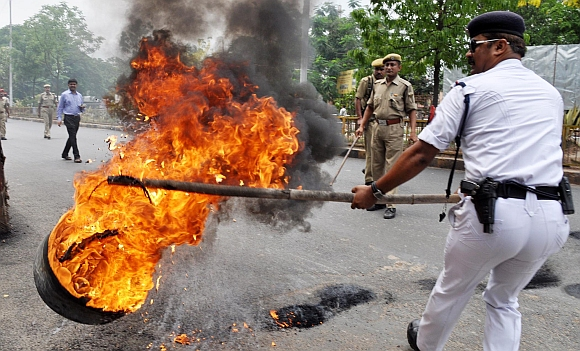 Bandh supporters burning tyres in front of Assam Secretariat in Guwahati on Thursday during the twelve-hour