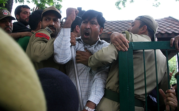 Communist Party of India-Marxist activists clash with the police during the bandh in Jammu