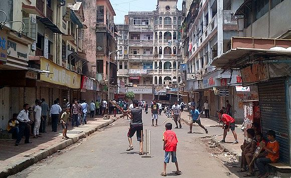 With Mumbai shutting down with glee, children took to the empty streets to indulge in their favourite sport: gully cricket