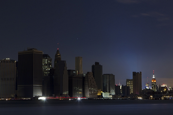 A largely powerless downtown Manhattan stands under a night sky due to a power blackout caused by Hurricane Sandy in New York