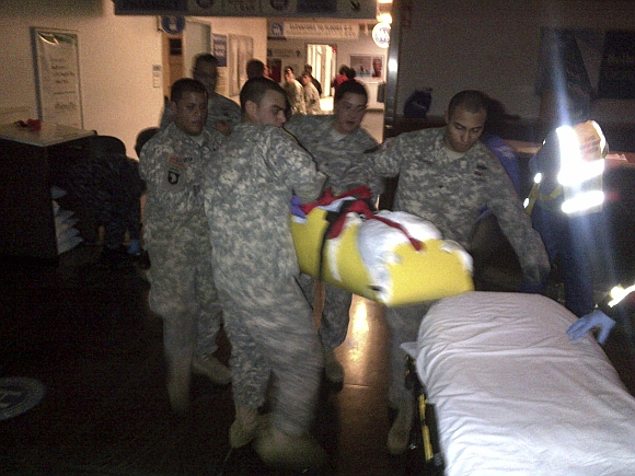 New York Army National Guard soldiers rush to evacuate a patient from Bellevue Hospital in New York