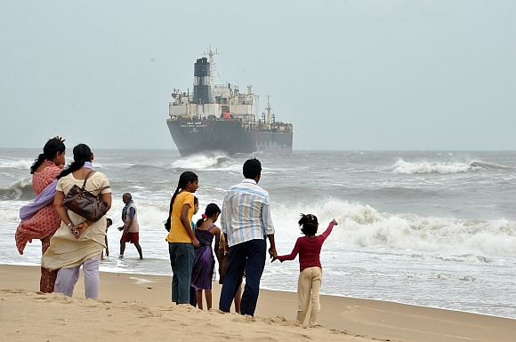 Onlookers watch ship Pratibha Cauvery