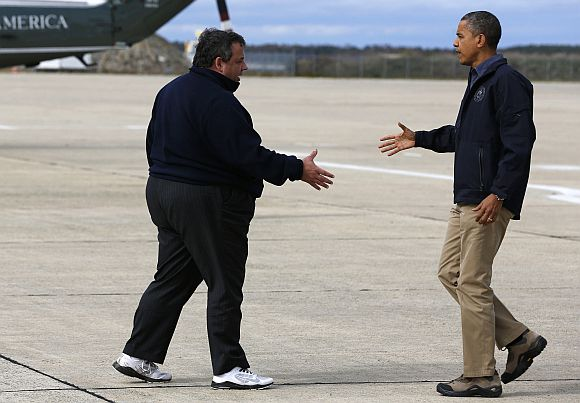 US President Barack Obama shakes hands with New Jersey Governor Chris Christie after he arrives at Atlantic City International Airport in New Jersey before surveying Hurricane Sandy damage