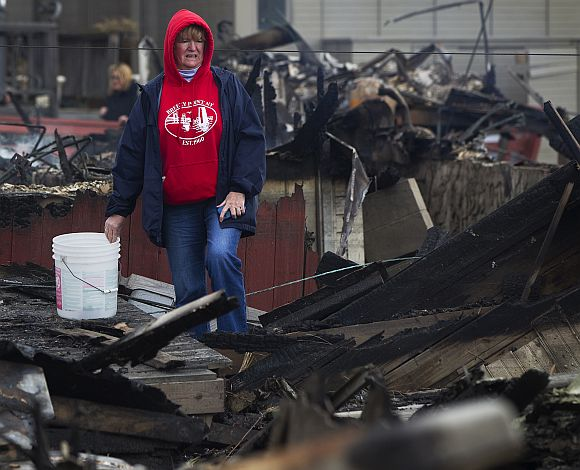 Sandy Aftermath: Grim faces say their story