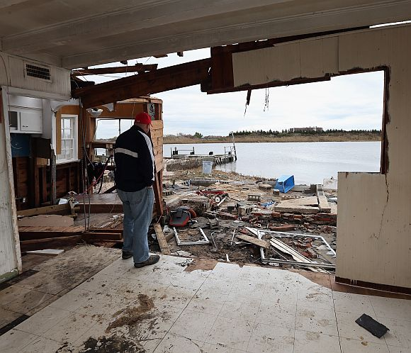 Gary Silberman looks out to an area that was his bedroom after it was destroyed by Hurricane Sandy in Lindenhurst, New York