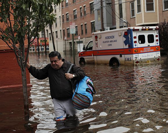 A man makes his way out of the floodwaters in Hoboken, New Jersey